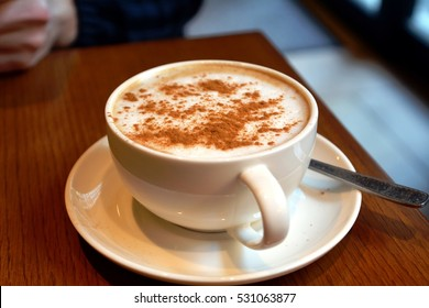 Delicious Foamy Italian Cappuccino On A Cup On A Table