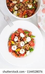 Delicious food: Homemade summer healthy salad with tomatoes on a white plate, closeup