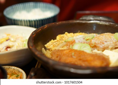 delicious food for hungry and life, hot fried fish with salad kimchi and rice at japanese cafe restaurant for lunch or dinner