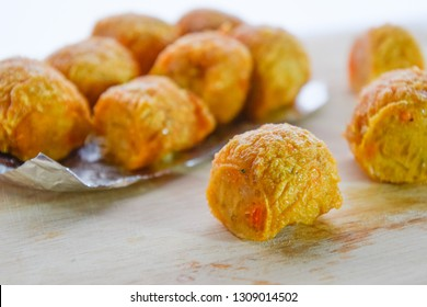 "Delicious food,  Thai people called ""Hoi cho"" : Jock fried shrimp on brown wood chopping board, Delicious snacks, on white background."