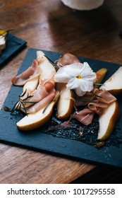 Delicious french food on a black plate