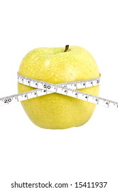 delicious fresh apple with a measuring tape wrapped around it. concept: weight loss, diet