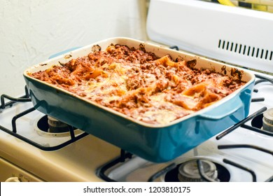 Delicious fresh cooked pan of lasagna cooling on the stovetop