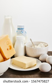 delicious fresh dairy products and eggs on wooden table isolated on white