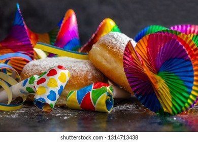 delicious fresh donuts, streamers, rotor spirals, and blackheads in front of black background