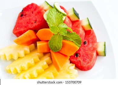 Delicious fresh fruit on white plate