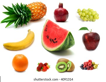 a lot of delicious fresh fruits and berries on white background