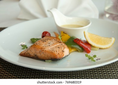 delicious Fresh grilled salmon steak slices and sauce