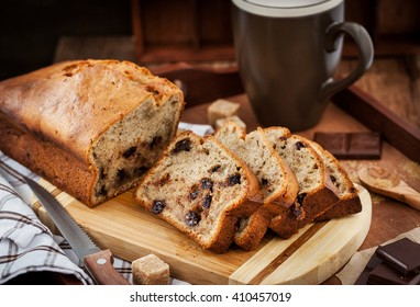 Delicious fresh homemade banana bread (loaf cake) with chocolate for breakfast