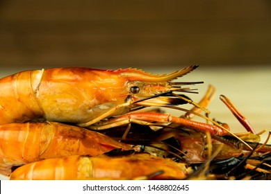 Delicious fresh jumbo grilled shrimps ( head on ), most popular Thai seafood on blur background.
