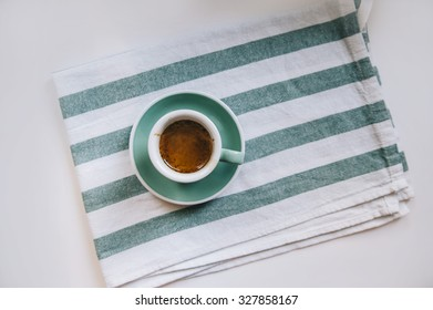 Delicious fresh morning double espresso on the kitchen cloth