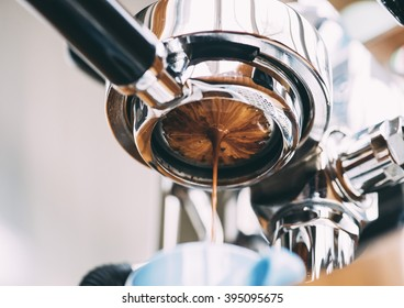 Delicious fresh morning espresso coffee with beautiful tiger crema pouring through the bottomless portafilter