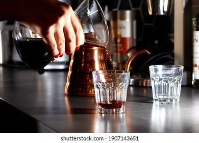 Delicious fresh morning pourover coffee pouring into the glass beaker from the the Glass pot