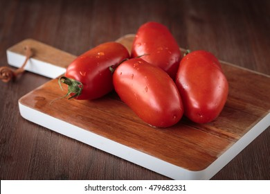 Delicious fresh raw San Marzano tomatoes for an healthy nutrition