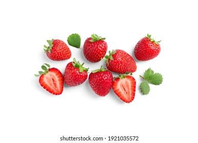Delicious fresh red strawberries and green leaves on white background, top view