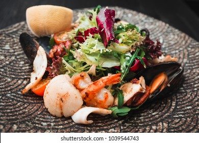 Delicious fresh salad of octopus,mussels and mixed lettuce leaves