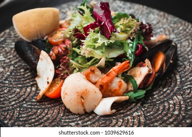 Delicious fresh salad of octopus,mussels and mixed lettuce leaves.