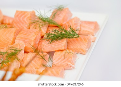 Delicious fresh salmon on white table with dill