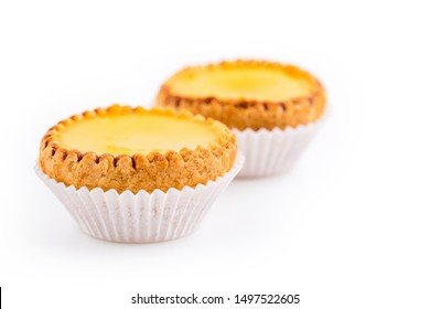 Delicious freshly baked egg tarts on white background