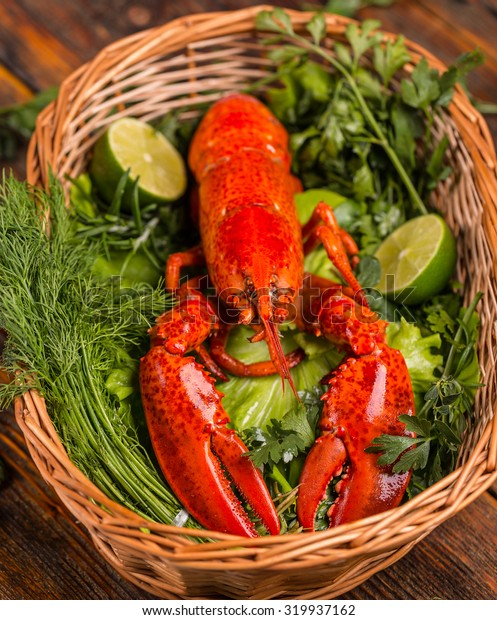 A delicious freshly boiled lobster with herbs