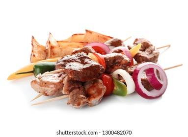 Delicious fried meat with garnish on white background