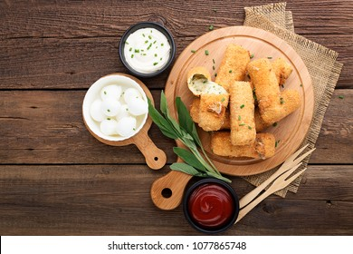 Delicious fried mozzarella cheese sticks. top view.