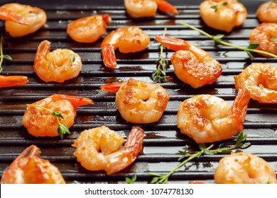 Delicious fried shrimps in grill pan, closeup