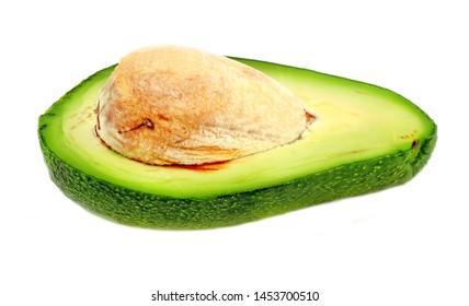 Delicious fruit avocados photographed closeup on a white background