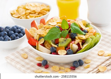 delicious fruit and berry salad for breakfast, close-up, horizontal