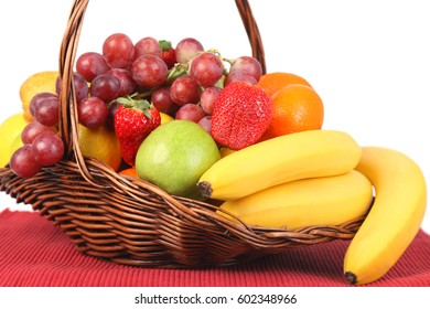 Delicious fruit and drink in front of white background