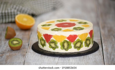 Delicious fruit mousse cake. Cake decorated with fresh fruits in jelly