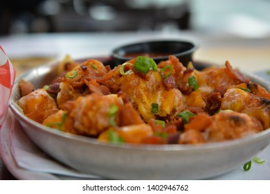 delicious fully loaded tater tots with cheese and bacon