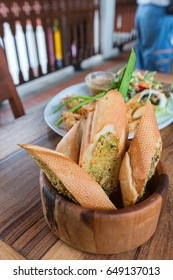 delicious garlic bread served in the wooden jar