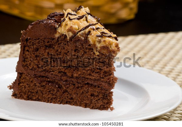 Delicious German Chocolate Fudge Cake with Coconut Topping on a White Plate