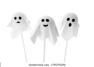 Delicious ghost cake pops on white background. Halloween holiday
