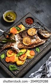Delicious gilthead fish baked with vegetables.  Dorado grill.