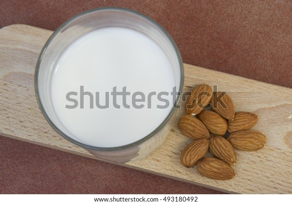Delicious glass of fresh milk mountain flavored almonds