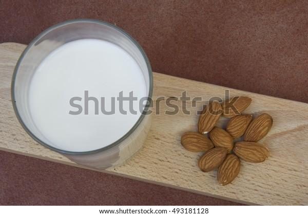 Delicious glass of fresh milk mountain flavored almonds