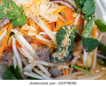 A delicious glass noodle salad with beef, peanuts and papaya is ready for dinner.