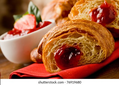 delicious golden croissants filled with strawberry marmalade