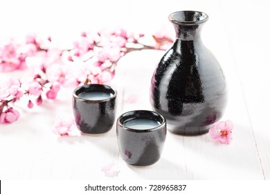 Delicious and good sake on white table