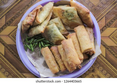 Delicious Gorengan Martabak and Lumpia Served with Hot Chili Pepper