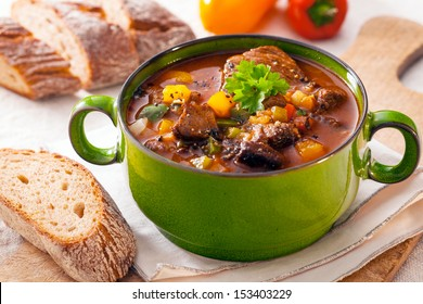 Delicious goulash casserole in a metal pot with thick rich gravy, meat and vegetables for a wholesome meal