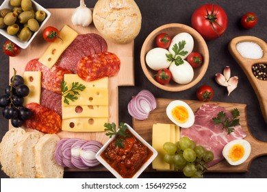 Delicious gourmet appetizer or breakfast in restaurant or smorgasbord with meat, cheese, tomato and boiled eggs.