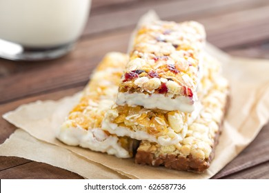 Delicious granola bars with oat, honey and yogurt, healthy food for breakfast. Homemade cereal snacks for healthy eating