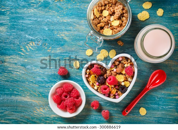 Delicious granola with berries. Healthy breakfast. View from above