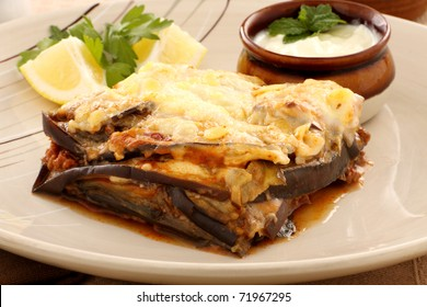 Delicious Greek moussaka with aubergine and a side garden salad.