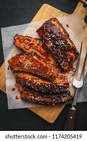 Delicious grilled bbq ribs on the cutting board, top view.  Traditional american Smoked Roasted pork ribs.