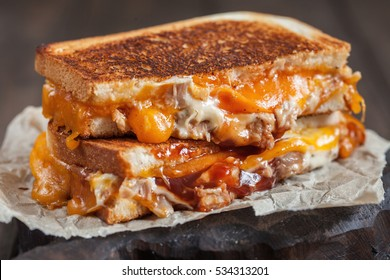 delicious grilled cheese sandwiches with chicken cut in half