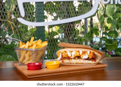 Delicious grilled hotdog in a restaurant, Homemade Bacon Wrapped Hot Dogs